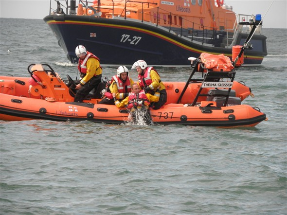 Photo:Dragging local crew member to safety