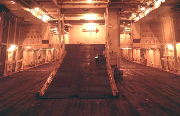 Photo:Car deck with ramp to upper level