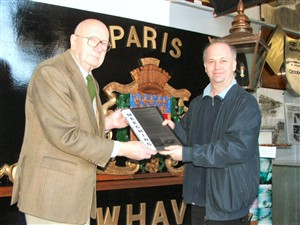 Photo:Andy Gilbert presents the book to Museum curator Peter Bailey.