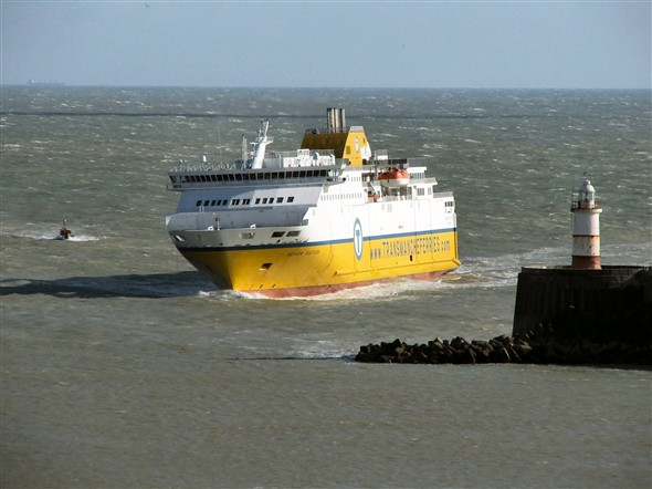 Photo:Rounding the breakwater. The little pilot boat sensibly stayed in the lee of Seven Sisters on the way in.