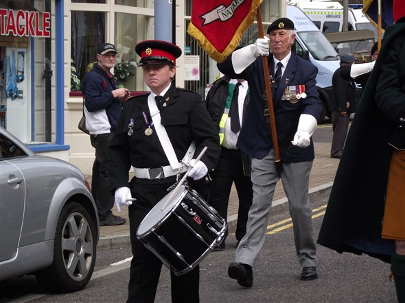 Photo:Heidi Watkins Drumming the parade back to the Island followed by Trevor Evans Standard Bearer for Canadian HQ Canadian Vets Assn. UK.