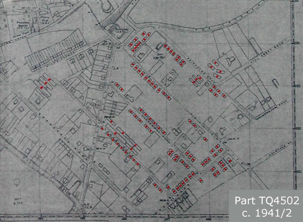"Photo:A corner of Ordnance Survey map TQ4502 (Scale 1:2500 or 25.344"" per mile) (undated but presumed 1942-ish) is reproduced here that shows all but two Nissen huts and military communal buildings on Mount Pleasant and correlates closely with those visible in the abovementioned photographs. It lacks only the two larger huts on the corner of King's Avenue and Arundel Road on the spare plots opposite the three huts shown here; these must have been late additions."