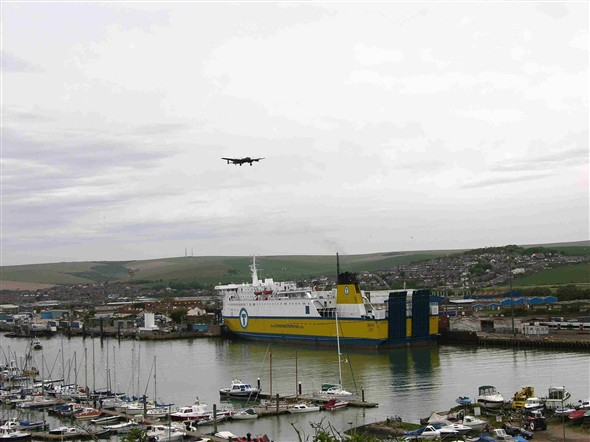 Photo:Lancaster Bomber from Battle of Britain memorial flight flying along the river and out to sea.
