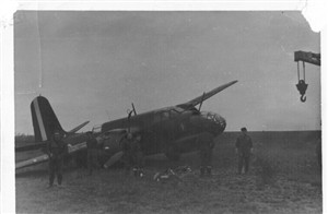Photo:Perrins aircraft after crash landing back at Vitry-en-Artois due to flak damage