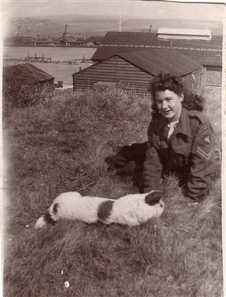 Photo:Freda Osborn with the Drill hall in the background
