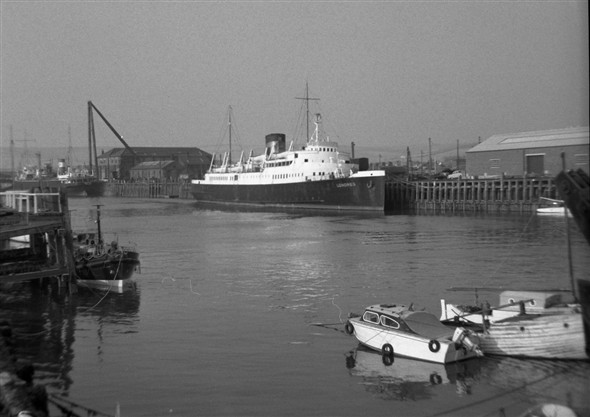 Photo:Londres at the Railway Quay in the Autumn of 1963. Withdrawn from service at the end of the season, she awaits sale to Greek owners at the end of the year. The dredger AA Raymond is undergoing conversion up at the Marine Workshops, and I wonder what our lifeboat Kathleen Mary is doing so far upriver.