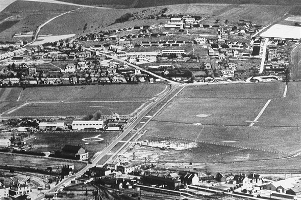 Photo:Diagonal aerial view of Mount Pleasant c.1950 showing the Nissen huts and some of the remaining communal huts (Ablutions, Mess huts, & N.A.A.F.I.) huts, a few of which have already been demolished at the NW end of Arundel Road by the time of this photograph. Many of the chalk footpaths between the huts are still prominent.
