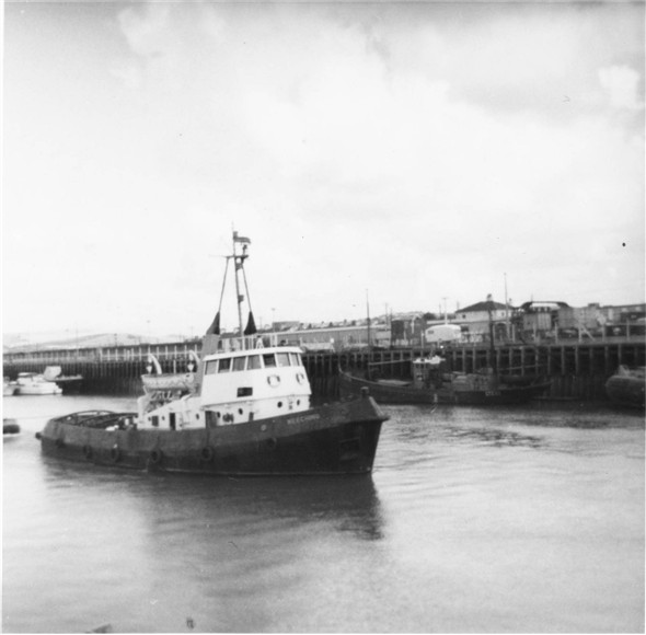 Photo:Meeching tug making her way down the harbour - c1961