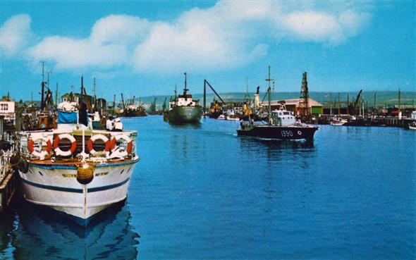 Photo:Busy harbour scene