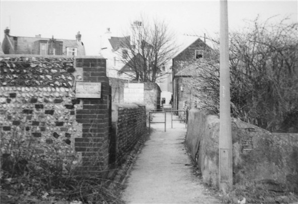 Photo:Into South Lane Sidney Cottage is now demolished behind the flint wall, the High Street is straight ahead - c1970