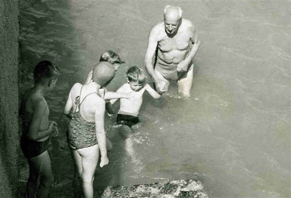 Photo:Ted Byrne Snr teaching local children to swim.
