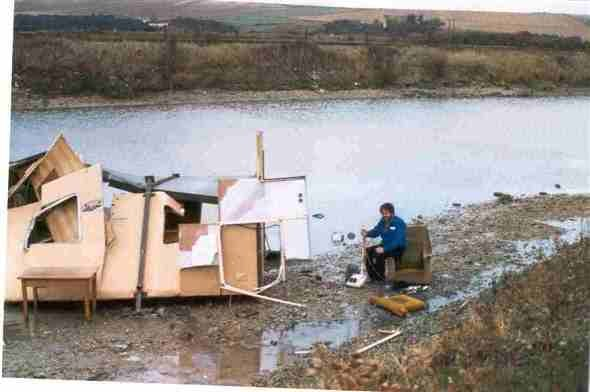 Photo:This picture shows my husband in his armchair still clutching his vacuum cleaner with his hut in pieces in the river.