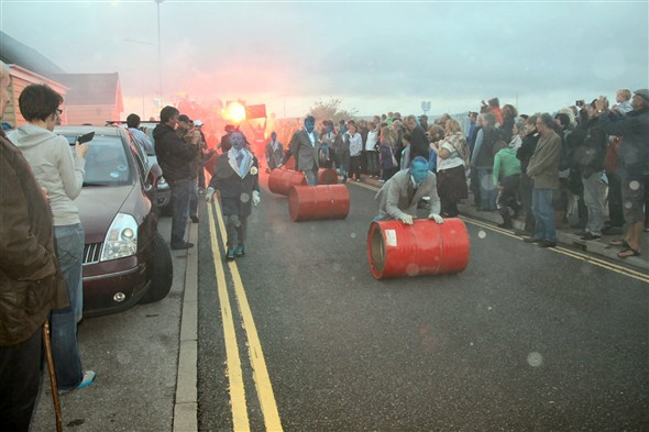Photo:They rolled and banged the oil drums