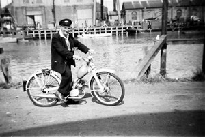 Photo:Early 1960s, at the West Quay on his NSU 'Quickly' bike