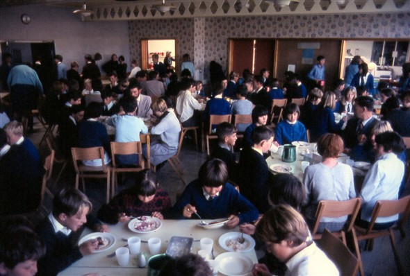 Photo:Dinner in the dining hall before it became the library/resource centre.
