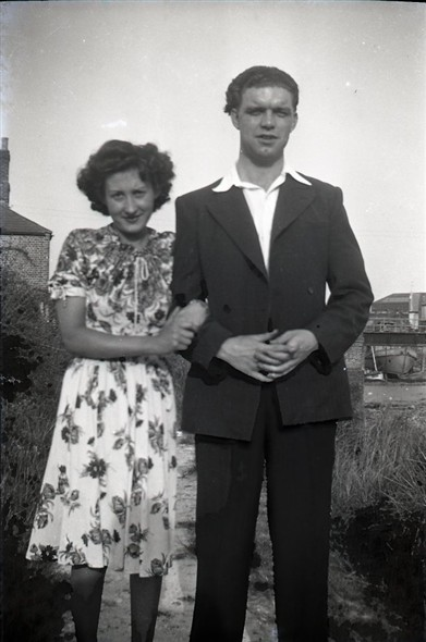 Photo:Photo 6: Marcia Stapley with unknown male. In view of Denton Island Bridge, circa late 1940s