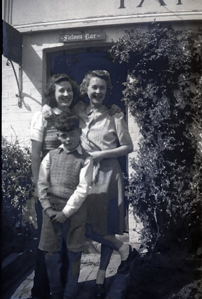 Photo:Marcia Stapley & Edwin Warnes. I thought the 3rd person was Marcia & Edwin's sister, Honor, but she says it's not her. Rose Cottage Inn, Alciston, late 1940s
