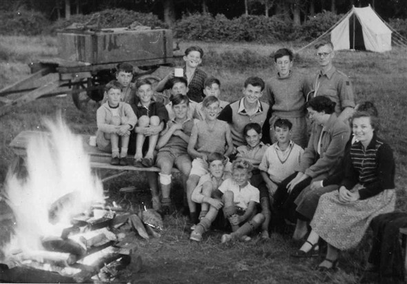 Photo:Camping at Ringmer. Left to right back row: David Penfold, Tom Ince, Adrian Hunkin, Eric Hunkin.  Sitting second row: Alan Wilson, Colin Holden, Brian Comben, Colin Smith, Jim Ince. Sitting third row: Micheal Poll, ? Jones, David Hedges, ?. The two girls I cannot remember, one was Jim`s sister and the other his girlfriend, I think. Sitting on the ground: ?, and Dieter Lewery.