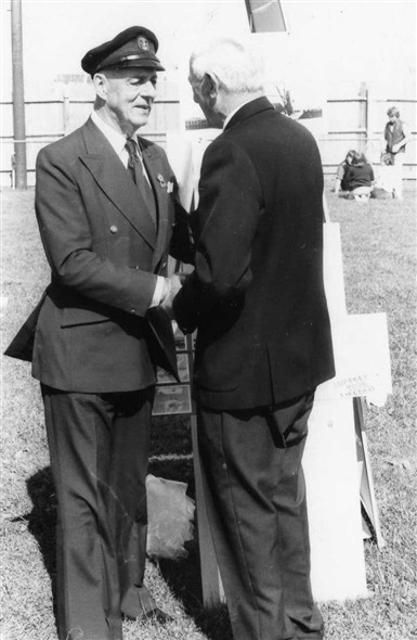 Photo:My father Bob welcomes Sir Alec to the Newhaven & Seaford Historical Society stand.