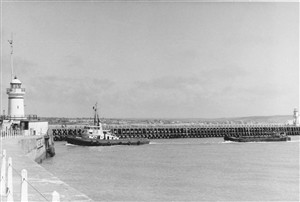 Photo:Another view of barge towing - note the West Pier lighthouse is still there and the concrete walls are still in good condition.