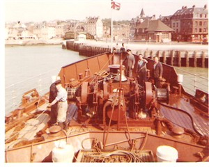 Photo:On the fore deck heaving off the quay in Dieppe, then departing.