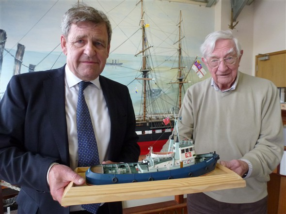 Photo:Commander Head hands the model over to Tony Helyar, Curator of Newhaven Museum