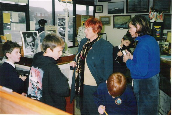 Photo:Paddy (Museum volunteer) and Jackie try and teach the children!