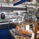 Photo:Lifeboat display and part of the main display cabinet