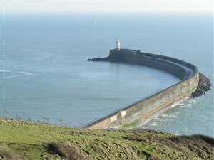 Photo:Newhaven harbour breakwater on a calm sunny day (27-01-2007) The lighthouse is unmanned.