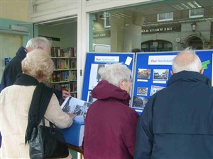 Photo:People looking at our information board