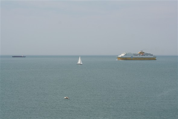 Photo:Making her approach, the smaller ship is the Aladin 1