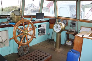 Photo:Starboard side of the wheelhouse, showing part of the new 'dashboard', including the radar screen. The ship's wheel and engine telegraphs are original.